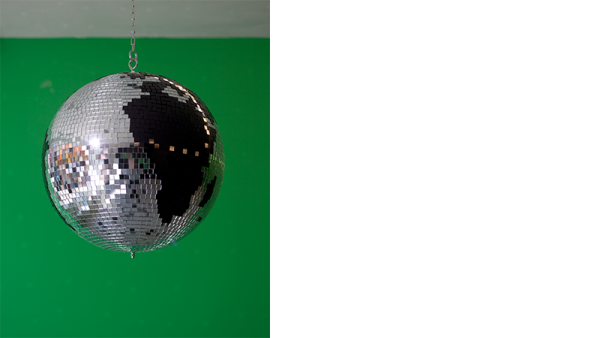 Disco Globe, Liz Magic Laser, 2013, mirrored glass, black glass, plastic core, chain and rotating motor, 16 x 16 x 16 in., edition of 5, installation view, Paula Cooper Gallery, New York.