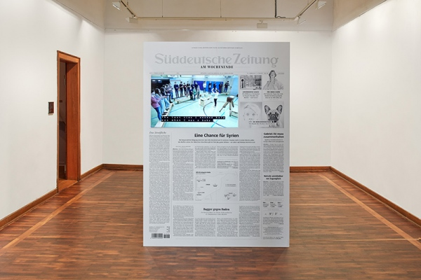 Identification Please, Liz Magic Laser, 2016, newspaper and video installation, 6:16 minutes, LED display, inkjet print, wood, glue, installation view Kunstverein Göttingen, Germany.