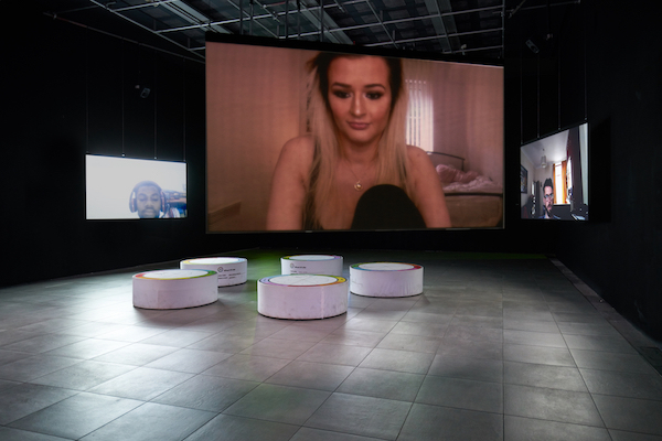 In Real Life, Liz Magic Laser, 2019, 5-channel HD video installation, 90 minutes; custom seating (dimensions variable). Commissioned by FACT, Liverpool, UK. Photo: Rob Battersby.