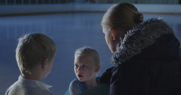 Kiss and Cry, Liz Magic Laser, 2015, single-channel 4K video, 13:30 minutes, video still. With figure skaters Anna MacKenzie and Axel MacKenzie and coach Marie Jonsson MacKenzie. Commissioned and produced by Mercer Union.
