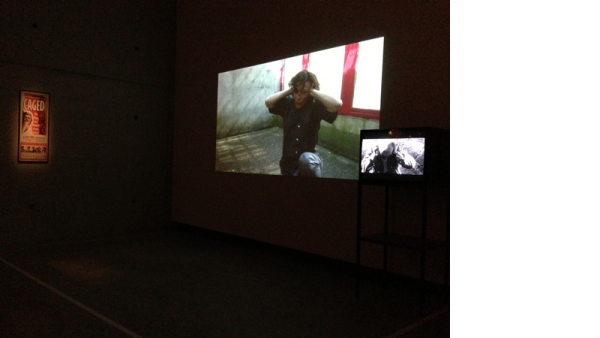 Prison Score, Liz Magic Laser, 2012, two-channel video and installation, 10 minutes, installation view, Contour 2013, Mechelen, Belgium.