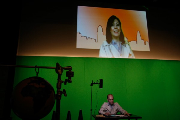 The Living Newspaper: On Location, Liz Magic Laser, 2013, performance and single-channel video, 42 minutes, production still, Plays and Players Theatre, Philadelphia, PA.